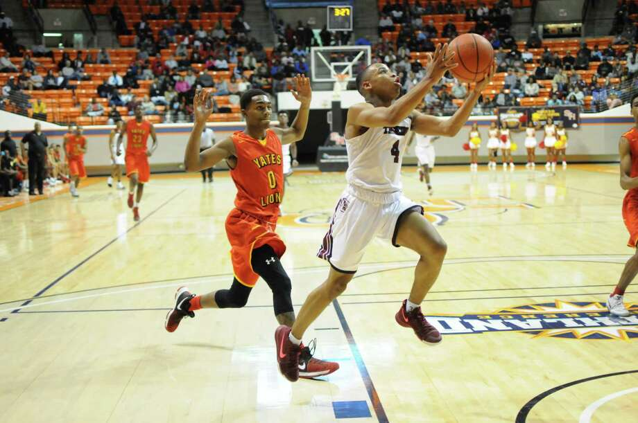 Silsbee freshman guard Braelon Bush (4) glides to the hoop as Houston Yates junior Wellington Stovall tries to keep from fouling during Saturday's Class 4A Region III final game at Sam Houston State University's Johnson Coliseum. (Gene Schallenberg/Special to The Enterprise)