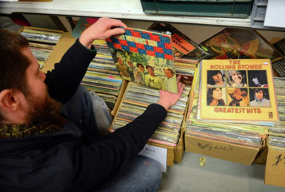 Chris Januski, of Bridgeport, looks for his favorite music at WPKN's MUSIC MASH 2017 Record Fair held at Read's Art Space apartments in Bridgeport, Conn., on Saturday Mar. 4, 2017.  Produced by nonprofit, community radio station WPKN 89.5-FM, this show now in its third year, has a bit more sizzle than the traditional record fairs. MUSIC MASH 2017 presents 50+ vendors from all over New England selling vinyl LP's, 45's, CD's and music collectibles. Photo: Christian Abraham / Hearst Connecticut Media / Connecticut Post