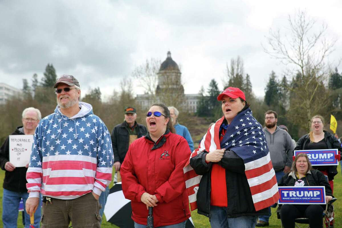 Several hundred pro-Trump and anti-Trump demonstrators gathered at the state capitol in Olympia, Washington, on Saturday, March 4, 2017. The