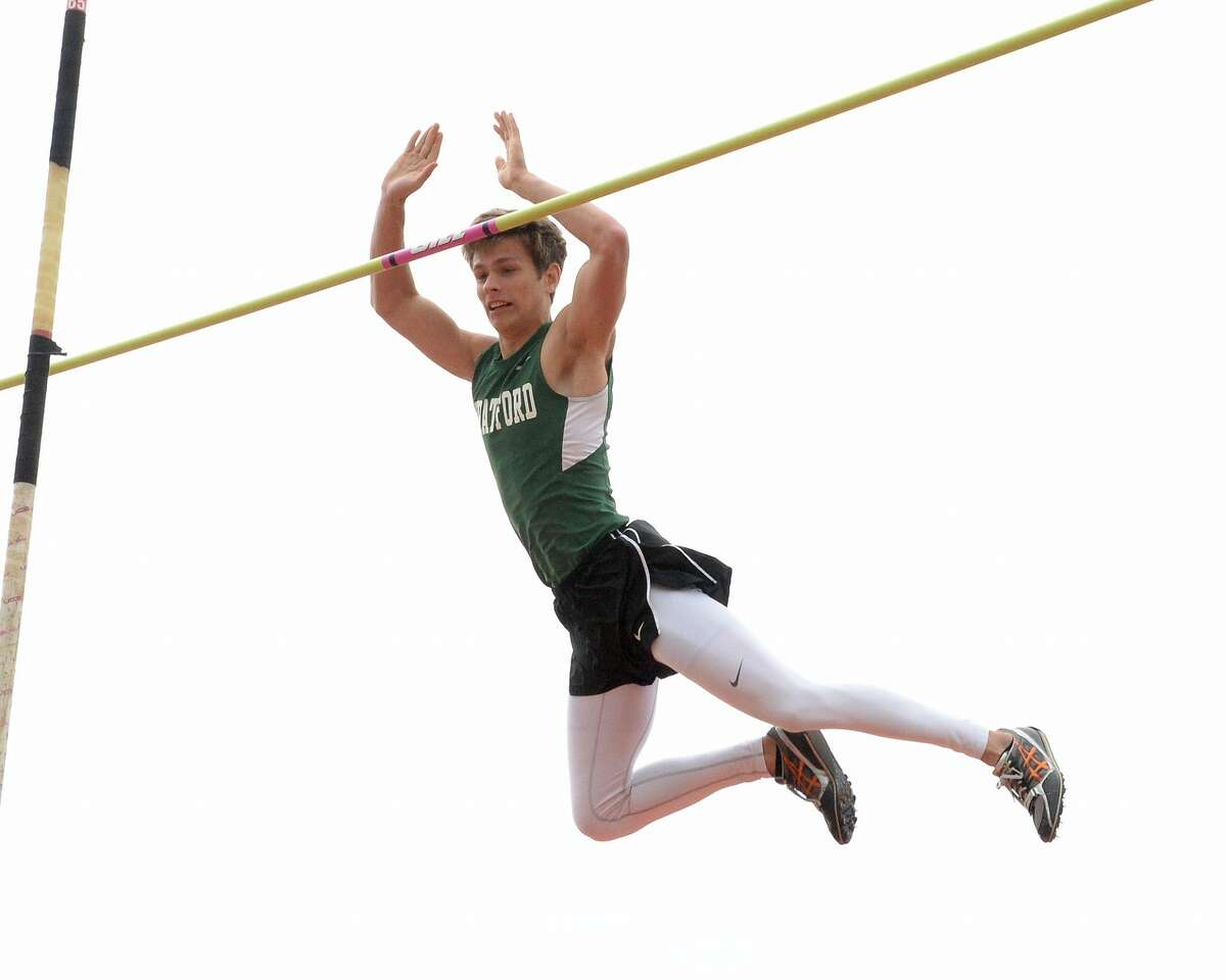 James Smith of Stratford wins second place in the pole vault by clearing a height of 14'6