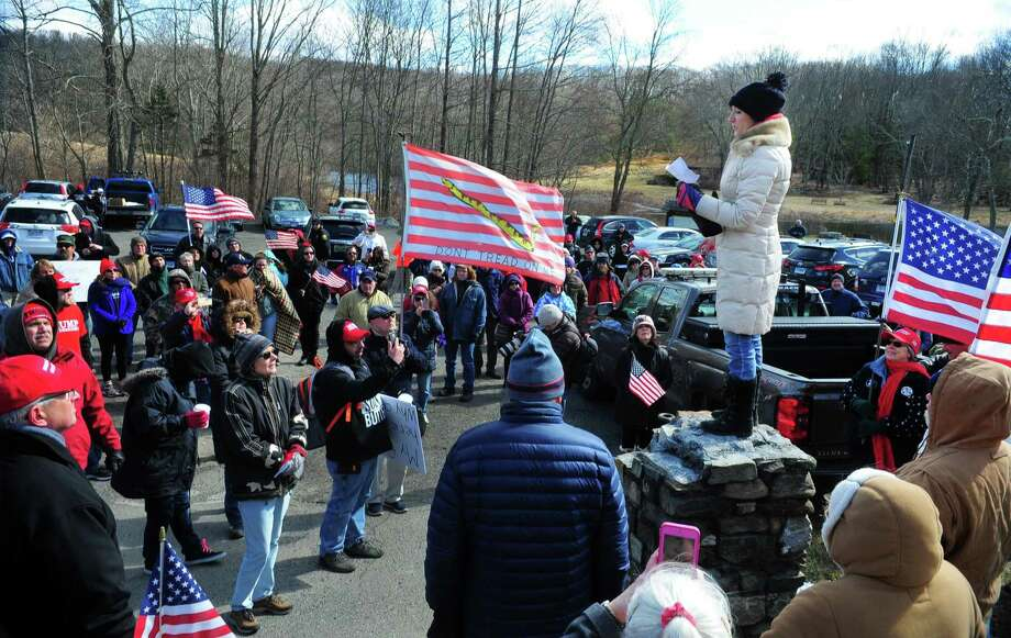 Rally organizer Kathryn Aiksnoras Dennen speaks to people gathered for the local March4Trump rally at Southford Falls State Park in Southbury on Saturday.  Mar. 4, 2017. More than 150 people attended the march which started at the state park, and made a short loop along a few back roads back to the park on Quaker Farms Road. The march was lead by Kathryn's sister Dorothy Aiksnoras-Vallee who used her landau carriage which was pulled by her Percheron draft horses Buster and Samson. This was a peaceful gathering for residents to show their respect and support for President Donald J. Trump and was part of the national March4Trump event coalition. Photo: Christian Abraham / Hearst Connecticut Media / Connecticut Post