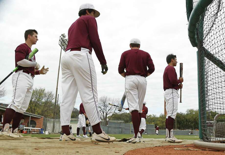Trinity players wait to take a turn at batting practice before their game against Babson College. A feature on the Trinity baseball program, a team that won its first national championship last season, and is in the rare opportunity window to play a season as reigning champs. Friday ,March 3, 2017. Photo: Ron Cortes, Freelance / For The San Antonio Express-News / Ronald Cortes / Freelance