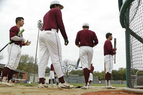 Trinity players wait to take a turn at batting practice before their game against Babson College. A feature on the Trinity baseball program, a team that won its first national championship last season, and is in the rare opportunity window to play a season as reigning champs. Friday ,March 3, 2017.