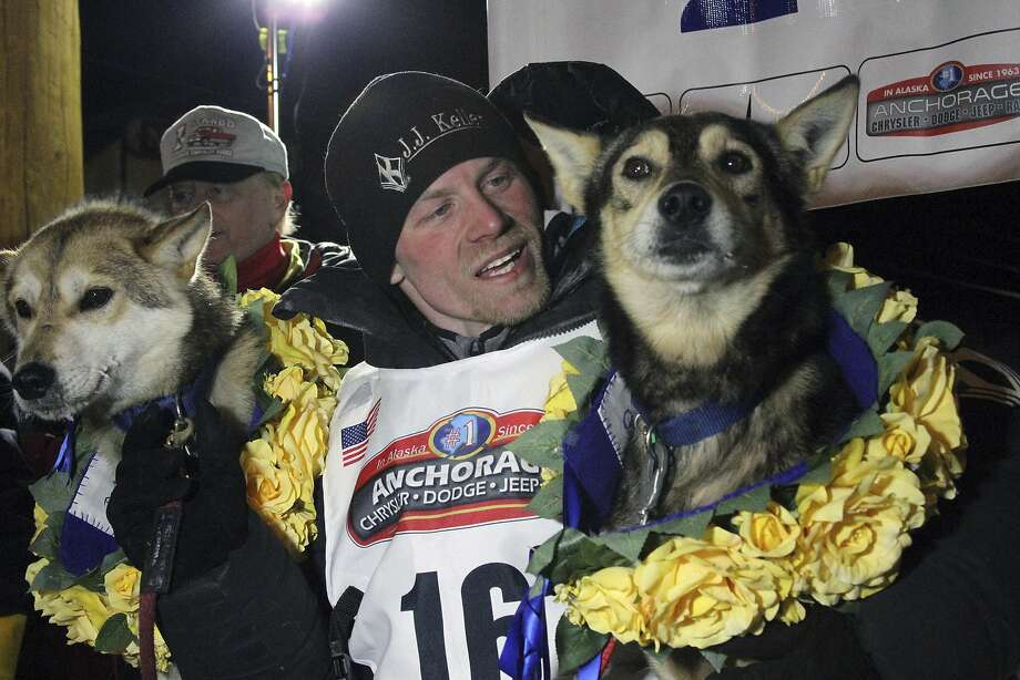 FILE - In this March 15, 2016, file photo, Dallas Seavey poses with his lead dogs Reef, left, and Tide after finishing the Iditarod Trail Sled Dog Race in Nome, Alaska. Iditarod officials have cleared a four-time champion of any wrongdoing in a dog-doping scandal that followed the sled dog race last year. Officials for the 1,000-mile (1,610 kilometer) Iditarod Trail Sled Dog Race issued a statement this week absolving Seavey of any involvement in the drugging of his dogs, the Anchorage Daily News reported. Photo: Mark Thiessen, Associated Press