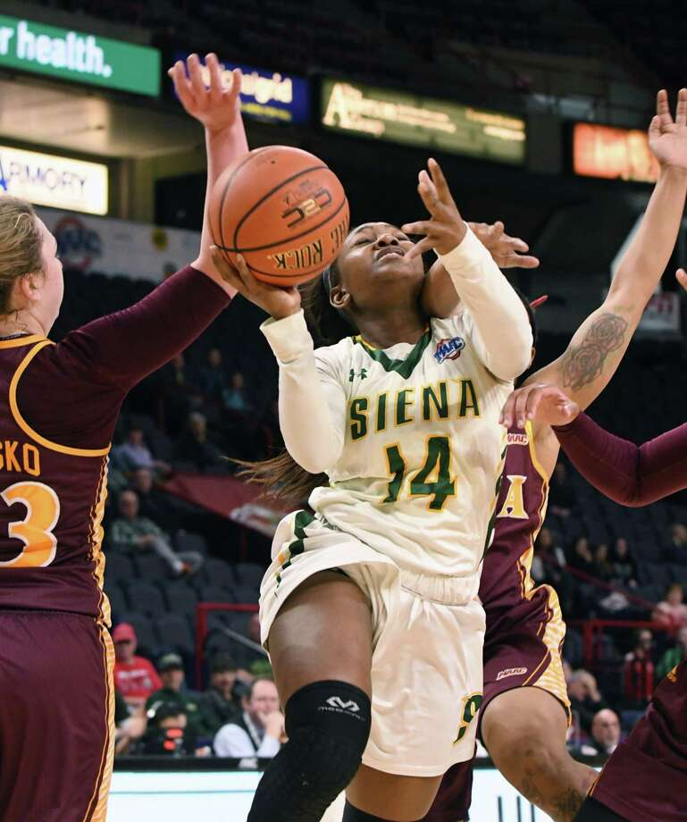 Joella Gibson of Siena drives to the net before being fouled during the first half against Iona at the MAAC Tournament on Saturday afternoon, March 4, 2017, at the Times Union Center in Albany, N.Y. (Will Waldron/Times Union) Photo: Will Waldron / 20039855A