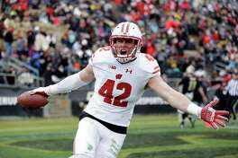 Wisconsin linebacker T.J. Watt celebrates after returning an interception for a touchdown during the first half against Purdue last November.