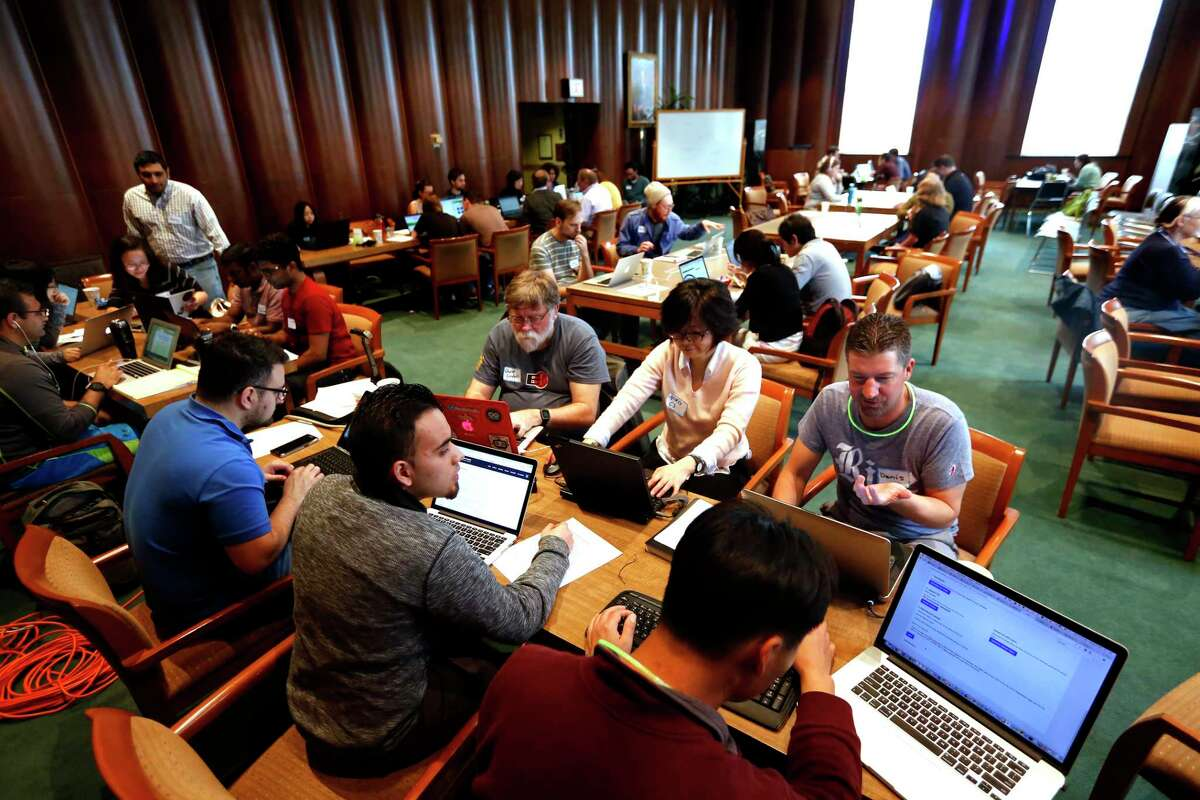 Students, staff and community members work together at the Fondren Library at Rice University on Saturday in Houston.