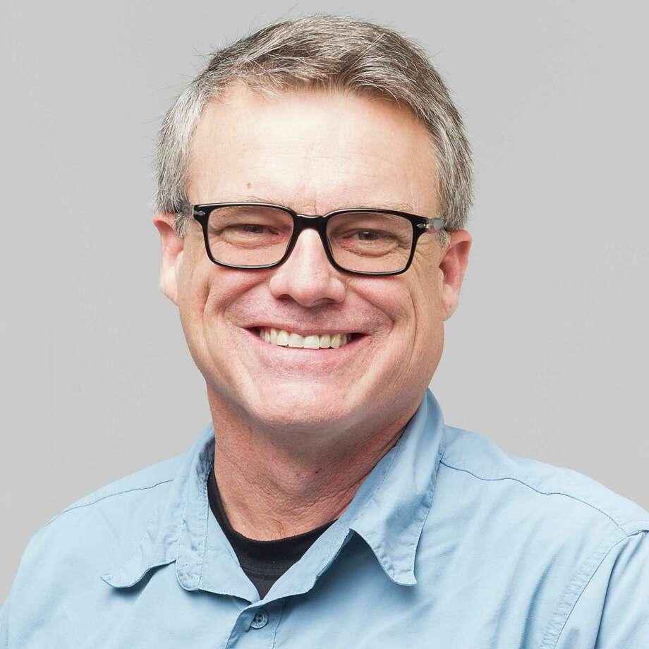 "Houston Chronicle staff photographer James ""Jake"" Nielsen in 2014. Photo: Johnny Hanson, Houston Chronicle / © 2014  Houston Chronicle"