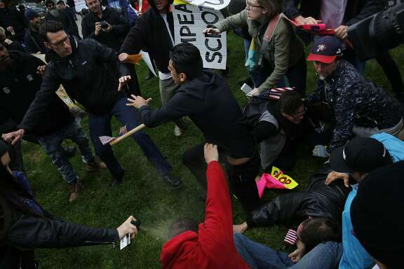 A Trump supporter gets pepper-sprayed as anti-fascist and Trump supporters brawl during a Pro-President Donald Trump rally and march at the Martin Luther King Jr. Civic Center park March 4, 2017 in Berkeley, Calif.