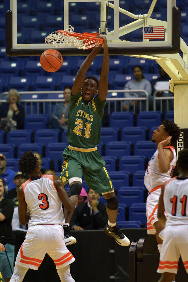 Cypress Falls junior forward Kendall Scott (21) had 12 points and 11 rebounds en route to helping the Eagles top Bush and secure a trip to the state semifinals. Photo: Jerry Baker, Freelance / Freelance