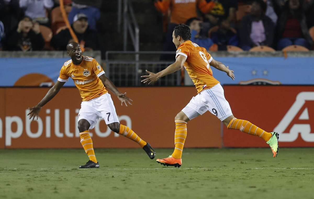 Houston Dynamo forward Erick Torres (9) reacts with DaMarcus Beasley (7) after Torres' free kick went in for the first goal of the night for the Dynamo during the first half of the season opening MLS soccer game at BBVA Compass stadium, Saturday, March 4, 2017, in Houston. ( Karen Warren / Houston Chronicle )