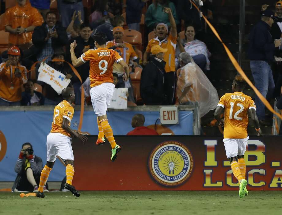 Houston Dynamo forward Erick Torres (9) reacts with DaMarcus Beasley (7) after Torres' free kick went in for the first goal of the night for the Dynamo during the first half of the season opening MLS soccer game at BBVA Compass stadium, Saturday, March 4, 2017, in Houston.  ( Karen Warren / Houston Chronicle ) Photo: Karen Warren/Houston Chronicle