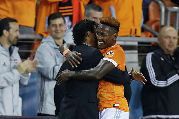 Houston Dynamo forward Romell Quioto (12) runs to hug head coach Wilmer Cabrera after Quito scored a goal during the first half of the season opening MLS soccer game at BBVA Compass stadium, Saturday, March 4, 2017, in Houston.  ( Karen Warren / Houston Chronicle )