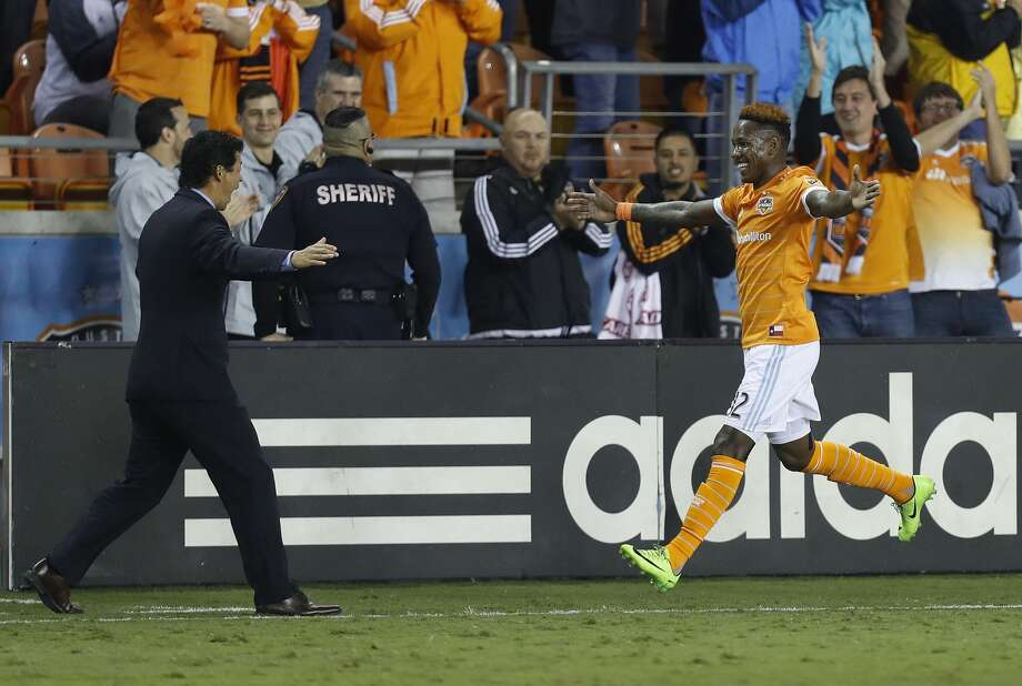 Houston Dynamo forward Romell Quioto (12) runs to hug head coach Wilmer Cabrera after Quito scored a goal during the first half of the season opening MLS soccer game at BBVA Compass stadium, Saturday, March 4, 2017, in Houston.  ( Karen Warren / Houston Chronicle ) Photo: Karen Warren/Houston Chronicle