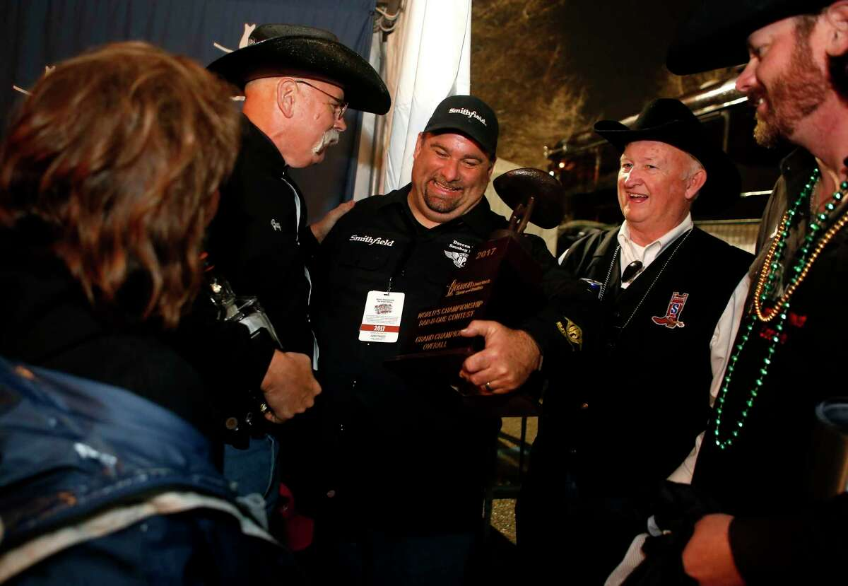 Darren Warth is congratulated by friends after winning Grand Champion at the World's Championship Bar-B-Que Cookoff on Saturday, March 4, 2017, at the Houston Livestock Show and Rodeo. (Annie Mulligan / Freelance)