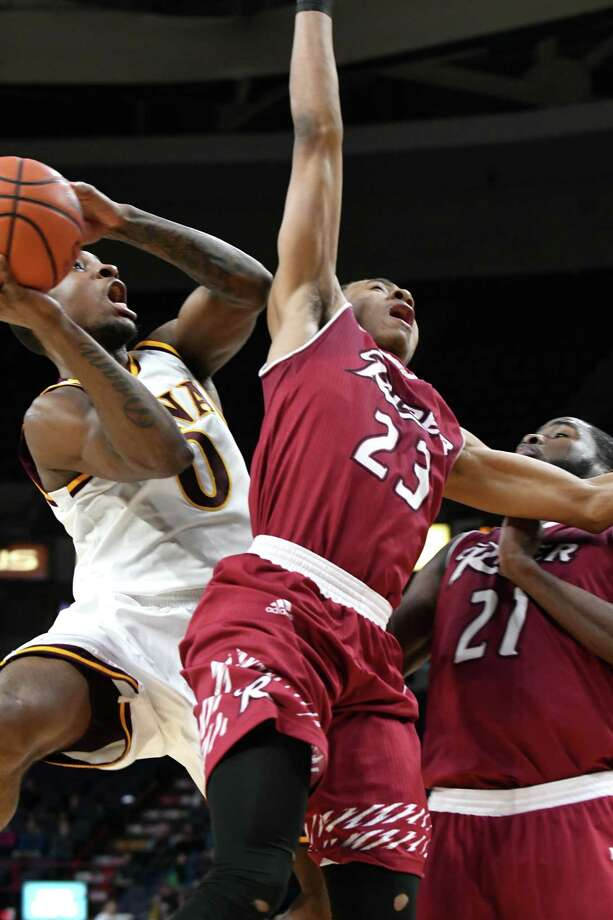 Rickey McGill of Iona, left, looks for room under the net against Stevie Jordan, center, and Norville Carey, right, of Rider during MAAC quarterfinals at the Times Union Center on Saturday night, March 4, 2017, in Albany, N.Y. (Will Waldron/Times Union) Photo: Will Waldron / 20039805A