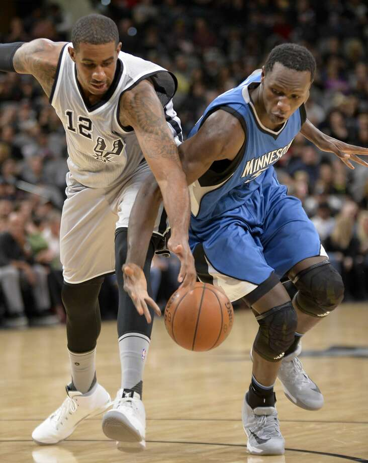 Minnesota Timberwolves center Gorgui Dieng, right, chases the ball against San Antonio Spurs forward LaMarcus Aldridge during the first half of an NBA basketball game, Saturday, March 4, 2017, in San Antonio. (AP Photo/Darren Abate) Photo: Darren Abate/Associated Press