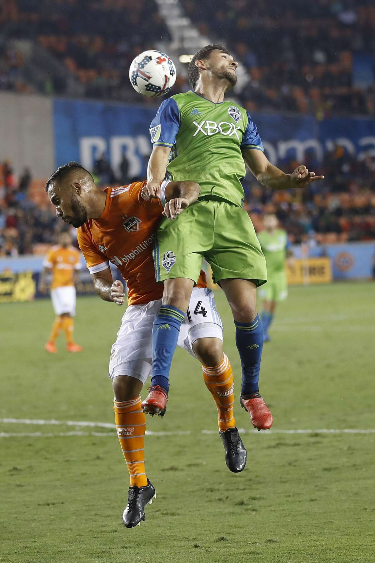Seattle Sounders midfielder Cristian Roldan (7) and Houston Dynamo midfielder Alex (14) go up for a header during the second half of the season opening MLS soccer game at BBVA Compass stadium, Saturday, March 4, 2017, in Houston. ( Karen Warren / Houston Chronicle )