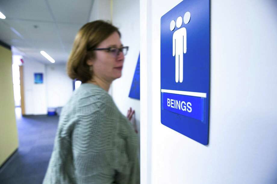 Rebecca Jeschke walks into a gender-neutral bathroom at the Electronic Frontier Foundation on Thursday, Dec. 15, 2016 in San Francisco, Calif. The foundation made its own gender-neutral sign. Photo: Santiago Mejia, Staff / The Chronicle / ONLINE_YES