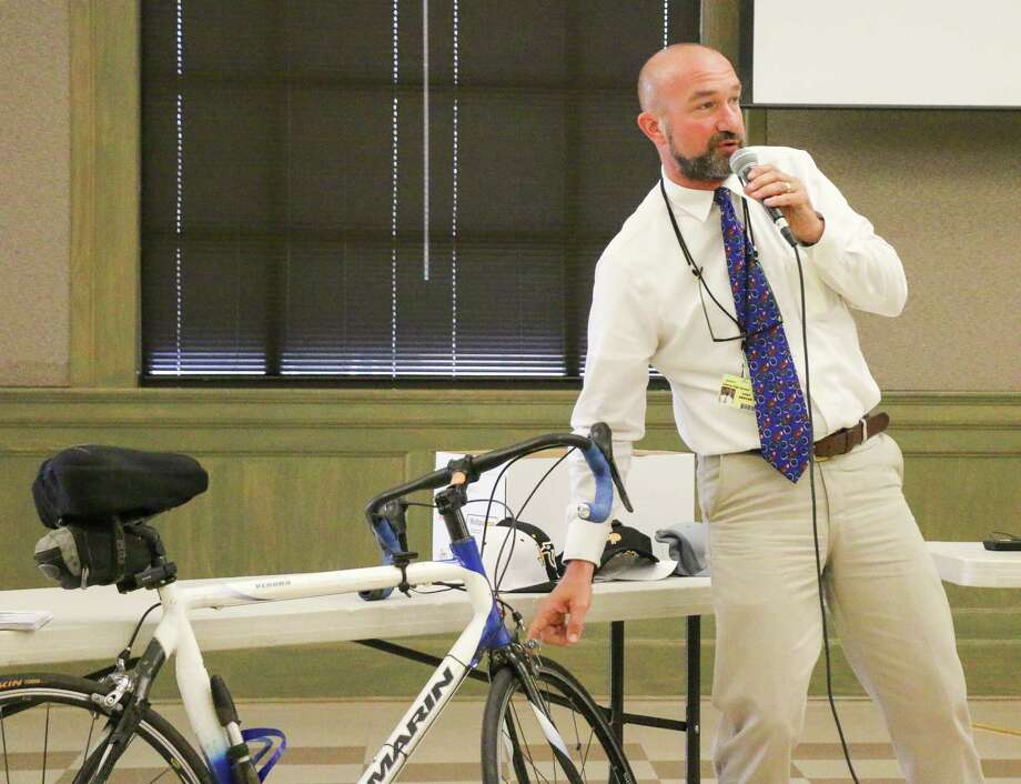 Liberty ISD Superintendent Cody Abshier demonstrates parts of one of the bikes he had on display at the Liberty Rotary Club meeting last week. Photo: David Taylor