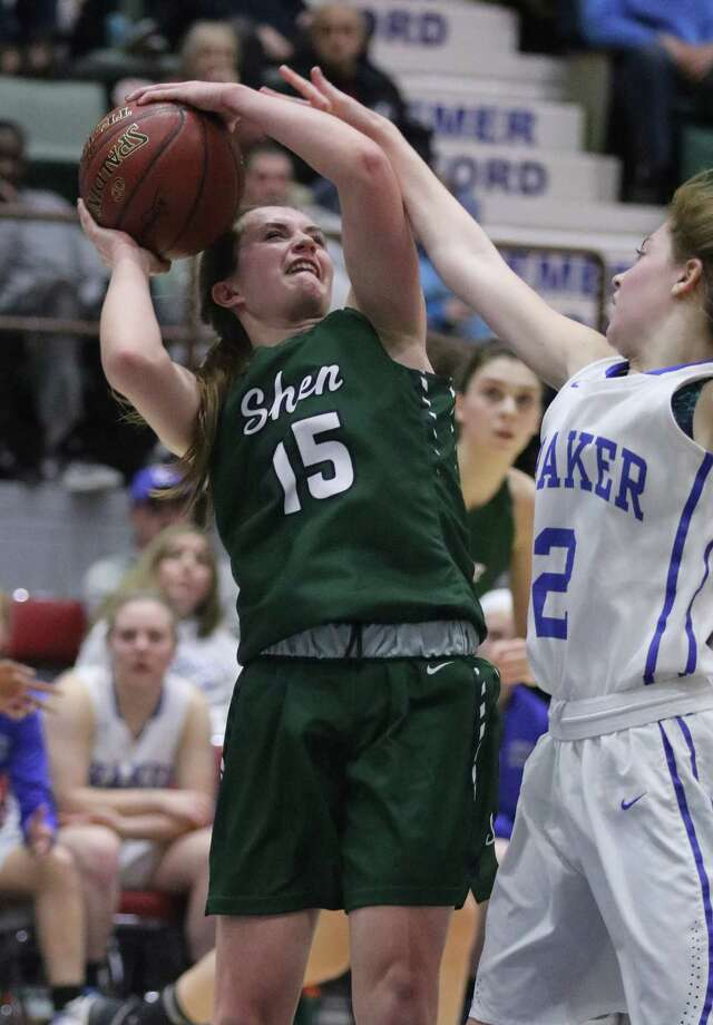 Shen's Megan Gillooley goes up for a shot pressured by Shaker's Maddy Malicki during the Section II Class AA girls' basketball final at the Glens Falls Civic Center Saturday, March 4, 2017. (Ed Burke-Special to The Times Union)