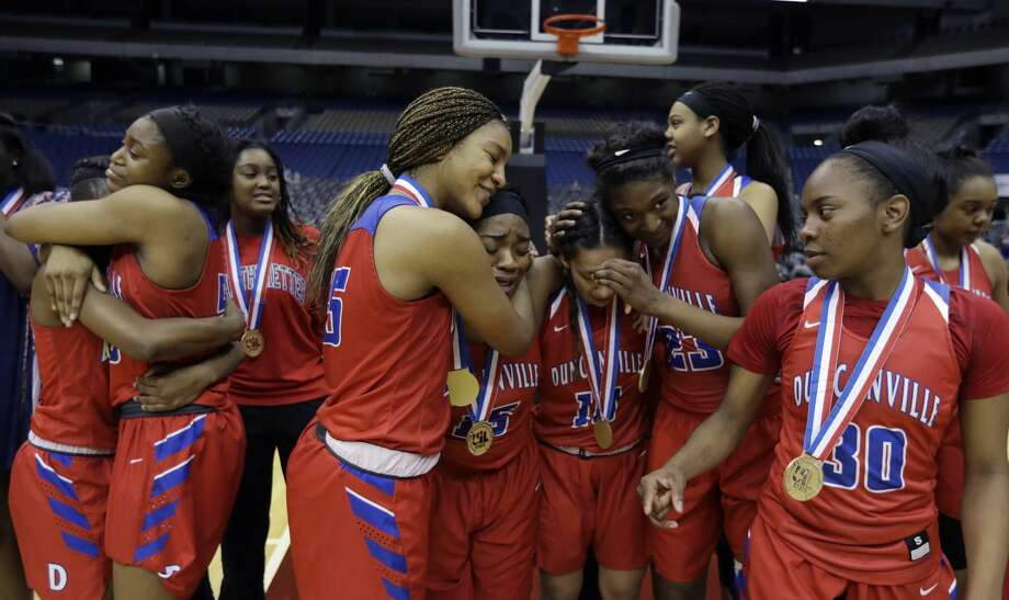 Duncanville players celebrate a win over Houston Cypress Ranch in the UIL girls' Class 6A state basketball final, Saturday, March 4, 2017, in San Antonio. (AP Photo/Eric Gay) Photo: Eric Gay/Associated Press