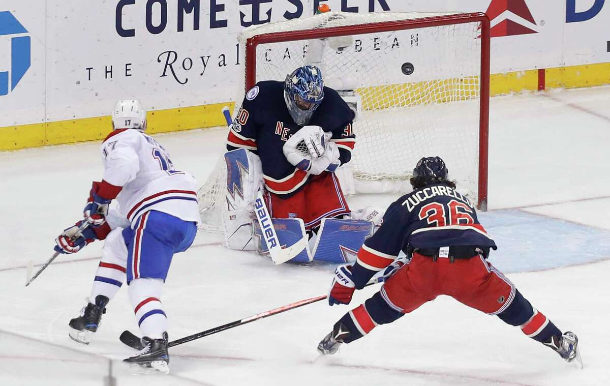New York Rangers goalie Henrik Lundqvist (30) deflects a shot by Montreal Canadiens center Torrey Mitchell (17) during the third period of an NHL hockey game, Saturday, March 4, 2017, in New York. The Canadiens won 4-1. (AP Photo/Julie Jacobson) ORG XMIT: NYJJ117