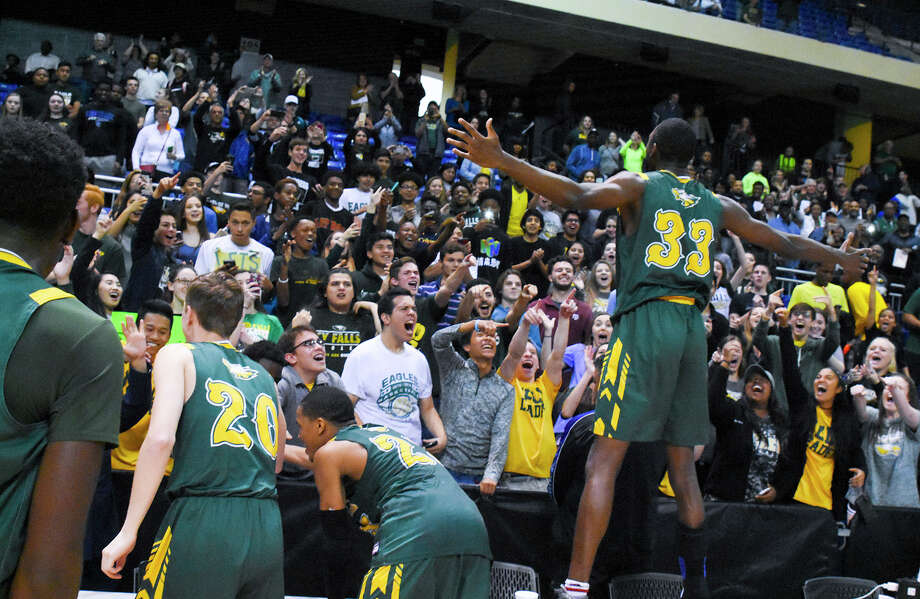 The Cy Falls Golden Eagles celebrate their region final victory over Fort Bend Bush at the Berry Center Saturday. Cy Falls won 73-63 in its first-ever region tournament appearance, earning the region crown and advancing to another first: the state tournament next week. Photo: Tony Gaines / HCN