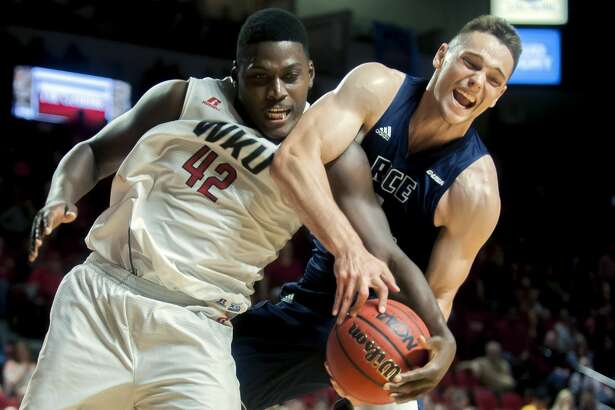 Western Kentucky forward Anton Waters (42) and Rice guard Egor Koulechov (4) battle for a rebound Saturday, March 4, 2017, during an NCAA college basketball game in Bowling Green, Ky. (Bac Totrong/Daily News via AP)