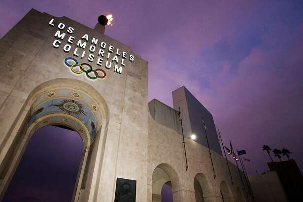 FILE - This Feb. 13, 2008, file photo shows the Los Angeles Memorial Coliseum in Los Angeles. The aging Los Angeles Memorial Coliseum is slated for a major overhaul, but it�s not known how much work will be needed to harden the structure against earthquakes in time to make a credible bid for the 2024 Olympics. The 1994 Northridge earthquake heavily damaged the stadium, even though it was 20 miles from the epicenter and the strongest shaking traveled away from the Coliseum (AP Photo/Damian Dovarganes, File)