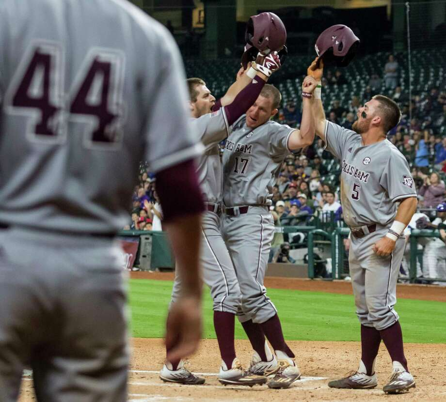 Texas A&M's Walker Pennington, Joel Davis (17) and Logan Foster (5) celebrate after scoring on Pennington's three-run homer in the first against TCU. For a game recap, go to chron.com/sports. Photo: Joe Buvid, Freelance / © 2017 Joe Buvid