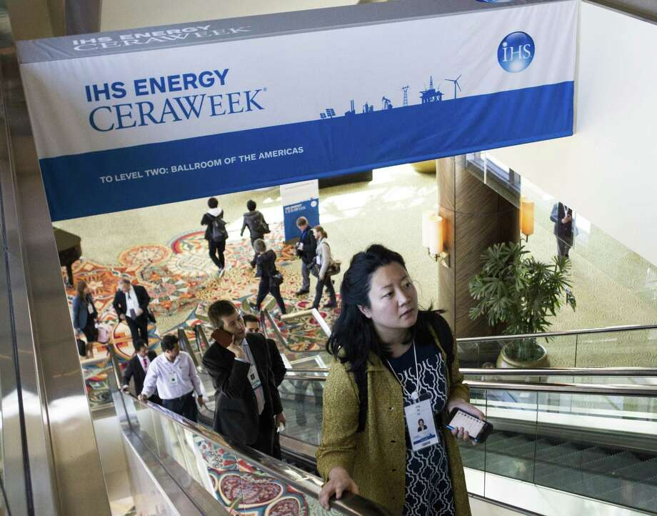 Attendees arrive to participate in last year's CERAWeek. Hydraulic fracturing, the surge of renewable energy and the global response to climate change — and their impact on ever volatile commodities markets — will be front and center when the 36th annual CERAWeek opens in Houston on Monday. Photo: Houston Chronicle /File Photo / © 2016 Houston Chronicle