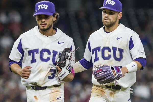 TCU third baseman Elliott Barzilli (3) and shortstop Ryan Merrill (5) comes off the field after recording the final out of the inning during a NCAA baseball game at Minute Maid Park on Saturday, Mar. 4, 2017, in Houston. (Joe Buvid / For the Houston Chronicle)