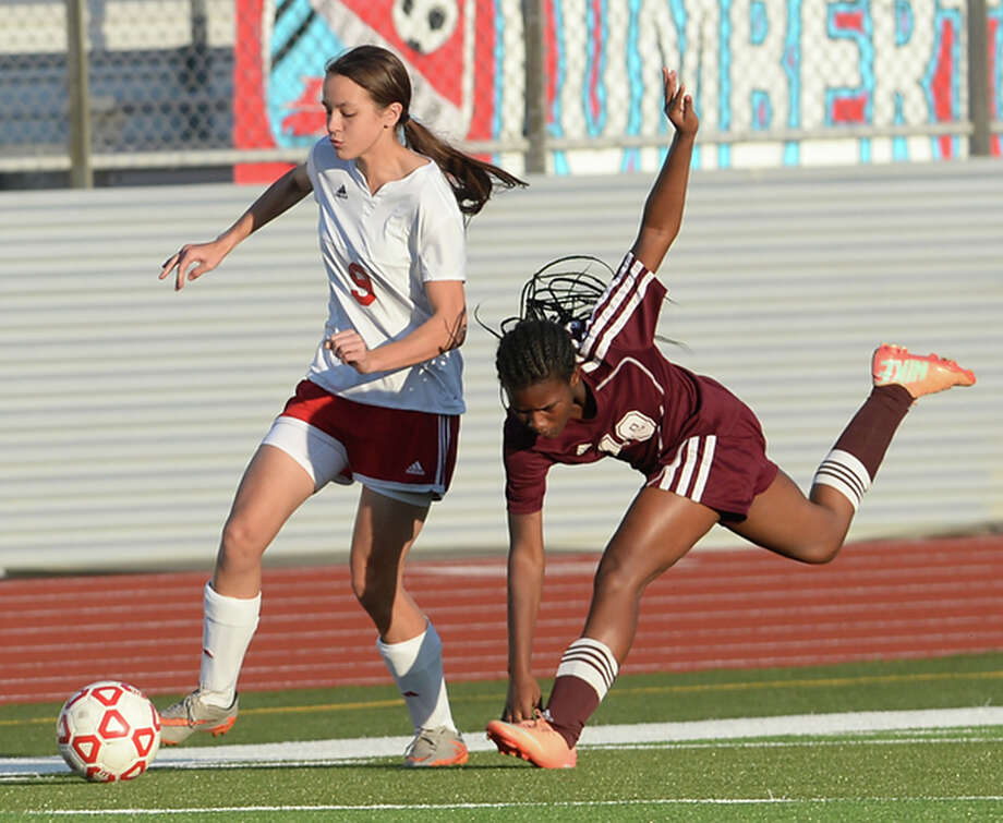 Lumberton's Baylee Flowers slips past Central's Sherrell Booker during their district match-up in Lumberton Friday. Photo taken Friday, March 3, 2017 Kim Brent/The Enterprise Photo: Kim Brent / BEN