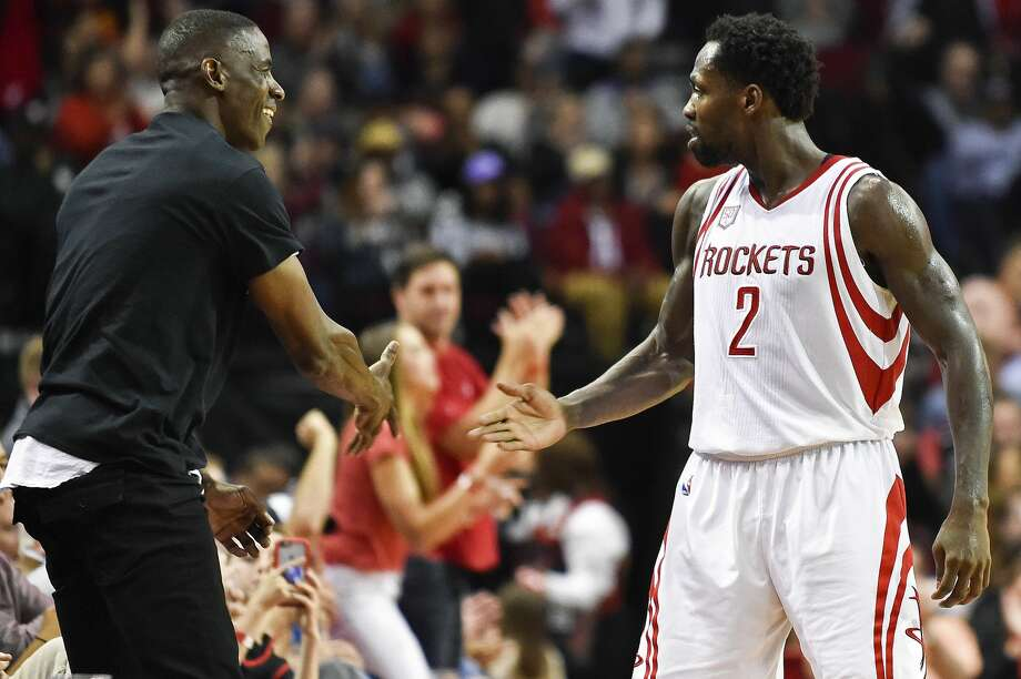 Houston Rockets guard Patrick Beverley (2) celebrates a 3-pointer by guard James Harden with ex-Houston Rockets player Vernon Maxwell, during the second half of an NBA basketball game against the Memphis Grizzlies, Saturday, March 4, 2017, in Houston. Houston won 123-108. (AP Photo/Eric Christian Smith) Photo: Eric Christian Smith/Associated Press