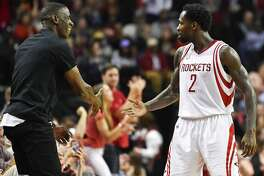 Houston Rockets guard Patrick Beverley (2) celebrates a 3-pointer by guard James Harden with ex-Houston Rockets player Vernon Maxwell, during the second half of an NBA basketball game against the Memphis Grizzlies, Saturday, March 4, 2017, in Houston. Houston won 123-108. (AP Photo/Eric Christian Smith)