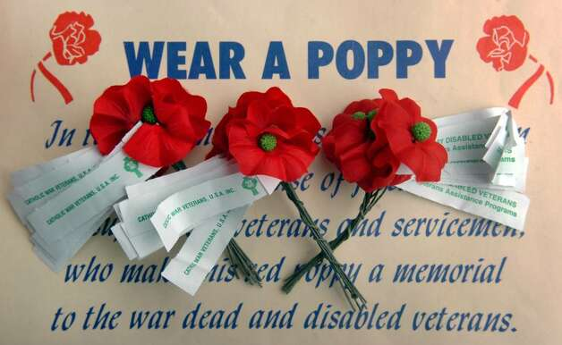 These poppies are handmade by disabled veterans, and are sold by a number of veteran's organizatons to raise money and awareness for disabled veterans. Photo: Ned Gerard / Connecticut Post