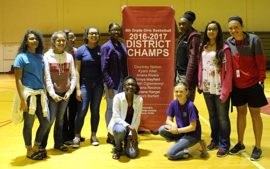 The Cleveland Middle School eighth-grade girls basketball team are the 2016-17 District Champions. The team includes (top row, left to right) Smiya Mayfield, Ariana Rivera, Head Coach Shatonja Jenkins, Viviana Recinos, Ajailah Ogienwonyi, Amani Bartlett, Adriana Rangel, Coach Alyssa Hollie; (bottom row) Kyara Allen and Courtney Nelson. Photo: Submitted