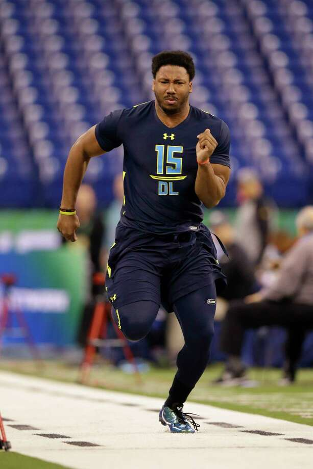 Texas A&M defensive end Myles Garrett runs a drill at the NFL football scouting combine in Indianapolis, Sunday, March 5, 2017. (AP Photo/Michael Conroy) Photo: Associated Press / Copyright 2017 The Associated Press. All rights reserved.