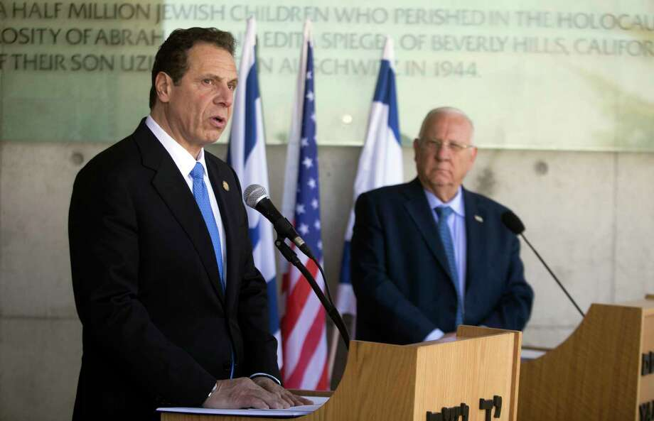 The Governor of New York Andrew M. Cuomo, left, and Israeli President Reuven Rivlin speak to the media at the Yad Vashem Holocaust memorial, in Jerusalem, Sunday, March 5, 2017. (AP Photo/Dan Balilty) ORG XMIT: DB113 Photo: Dan Balilty / Copyright 2017 The Associated Press. All rights reserved.
