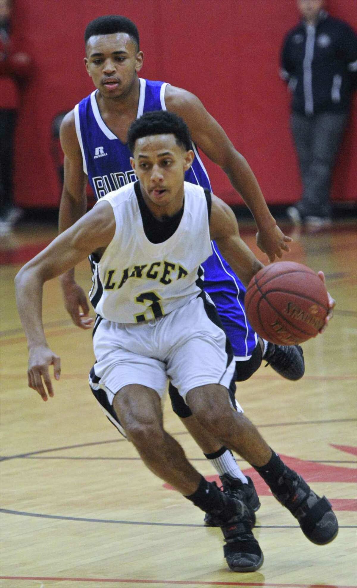 Notre Dame-Fairfield guard Tyler Bourne drives past a Bunnell defender during action in the SWC tournament championship on March 3. Bourne scored 21 points and was named the MVP as the Lancers rolled to an 88-62 win, capturing its second straight SWC crown.