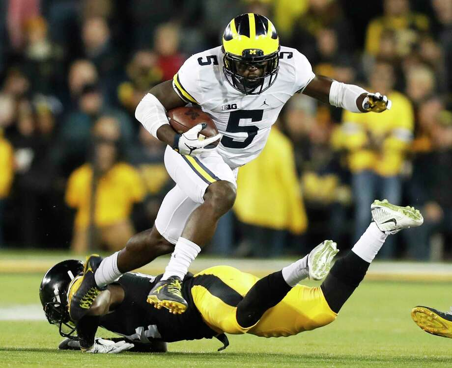 FILE - In this Nov. 12, 2016, file photo, Michigan's Jabrill Peppers (5) breaks a tackle by Iowa defensive back Desmond King, rear, during the first half of an NCAA college football game, in Iowa City, Iowa. Peppers was selected to the 2016 AP All-America college football team, Monday, Dec. 12, 2016. (AP Photo/Charlie Neibergall, File) Photo: Charlie Neibergall, Associated Press / Copyright 2016 The Associated Press. All rights reserved.