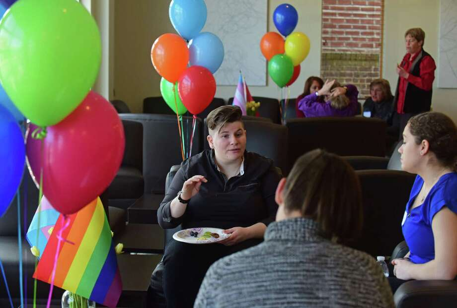 Erica Oliner, Sawyer Gaines and Marlee Ready have a chat as the Circle Care Center, The Triangle Community Center and the Mid-Fairfield AIDS Project (MFAP) open their doors Saturday afternoon, March 4, 2017, for tours of the building, conversations about their services and announcements of their new initiatives during an open house and day of empowerment for the local LGBTQ community at their facilty located at 618 West Ave. in Norwalk, Conn. Photo: Erik Trautmann / Hearst Connecticut Media / Norwalk Hour