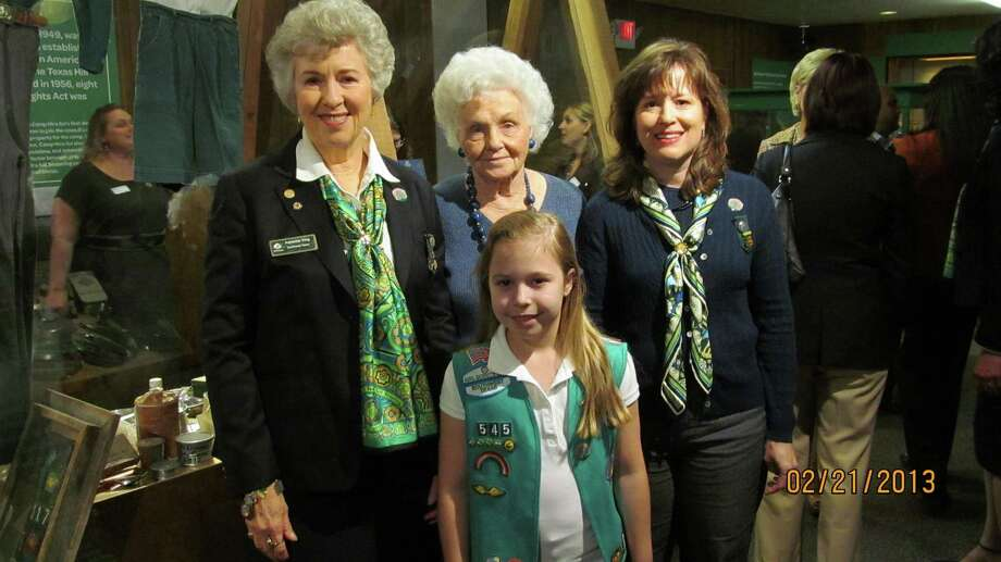 Four generations of San Antonio Girl Scouts visit the Girl Scouts 100-year anniversary exhibit at the Institute of Texan Cultures in 2013. At front is young Terra Fiedler. Standing behind her, left to right, are her grandmother, Adrienne W. King; great-grandmother, Marcella Wille; and mother, Kami Fiedler. Photo: Courtesy Photo /Adrienne W. King