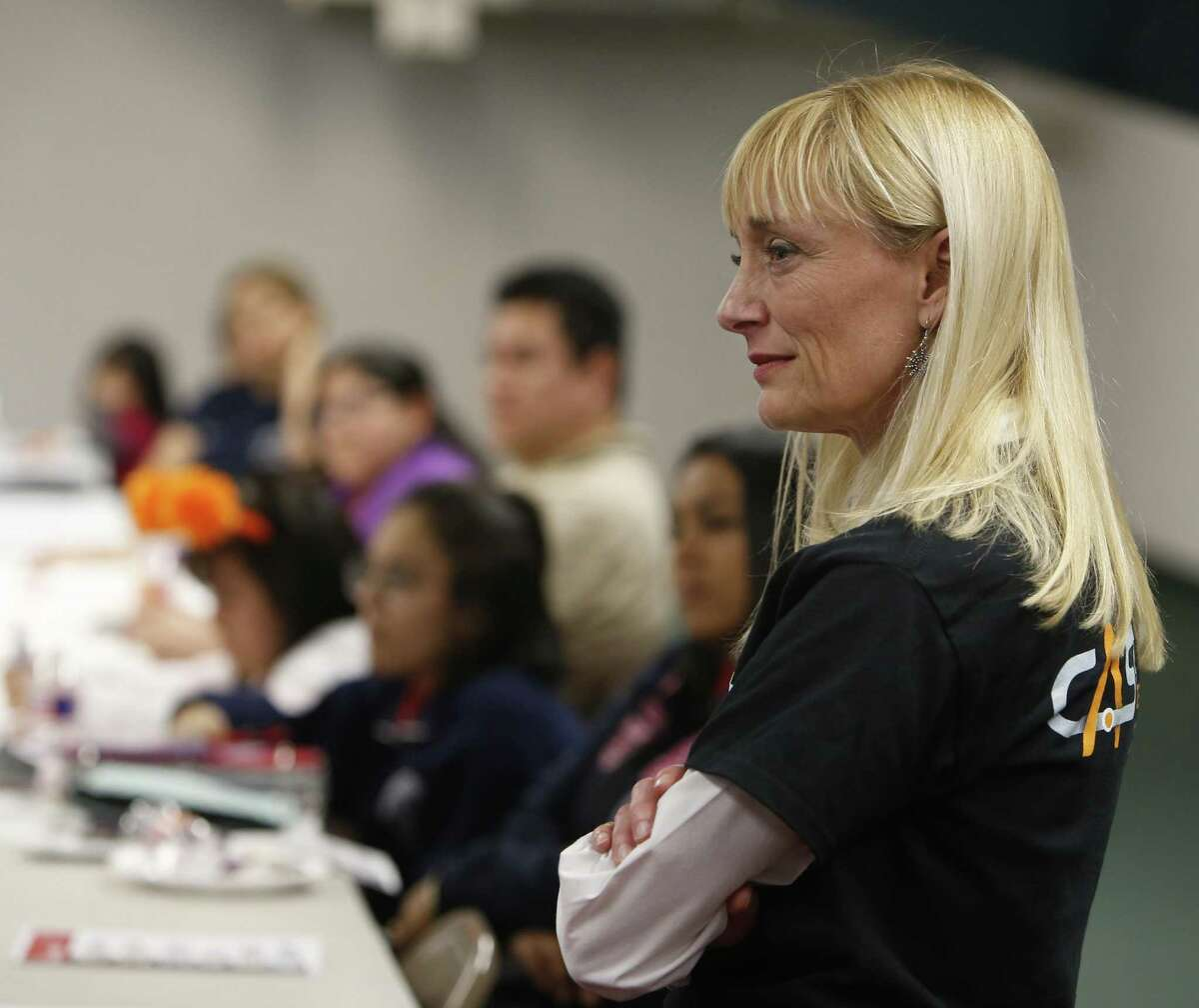 Kelly Isbell listens at an information session for middle school girls last March about CAST Tech High School, a partnership between SAISD, H-E-B and other local companies. Isbell was principal of the school, which will open this month with a focus on technology and entrepreneurship, but was abruptly fired and is suing the school district, her replacement and a consultant who she alleges conspired to have her removed.