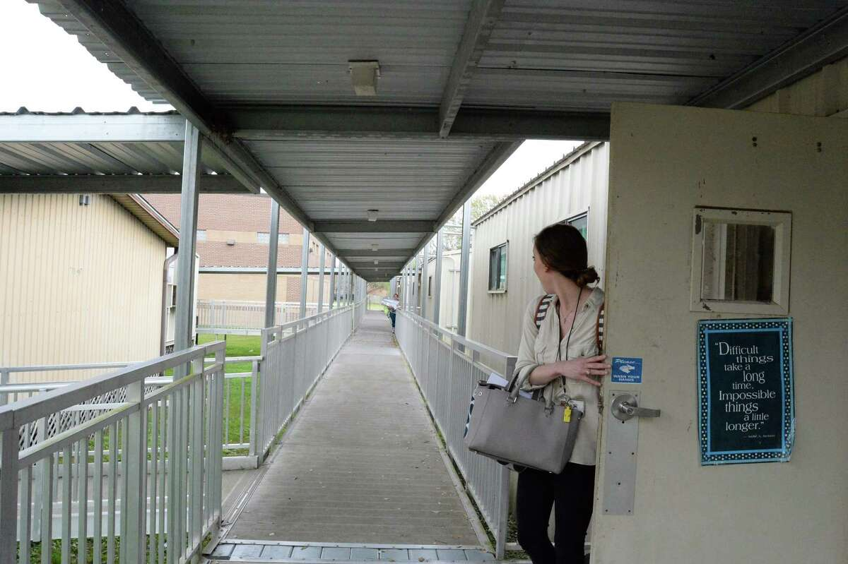 At Hall Elementary School in League City, fifth-grade teacher Lauren Legge locks up for the day. The school's 17 portable classrooms house the entire fifth grade. If voters approve a proposed Clear Creek ISD bond package, the school would get a major expansion and the portables would be replaced by green space.