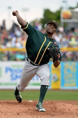 PEORIA, AZ - MARCH 05:  Jharel Cotton #45 of the Oakland Athletics delivers a pitch during the spring training game against the Seattle Mariners at Peoria Stadium on March 5, 2017 in Peoria, Arizona.  (Photo by Jennifer Stewart/Getty Images)