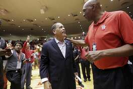 Houston Cougars head coach Kevlin Sampson talks with Elvin Hayes after the school's last game at Hofheinz Pavilion on Sunday, March 5, 2017, in Houston. Elizabeth Conley / Houston Chronicle )