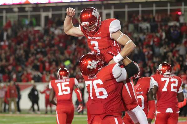 Houston Cougars quarterback Kyle Postma (3) celebrates with right guard Kameron Eloph after scoring a touchdown to give the Cougars the lead during the fourth quarter of an AAC football game at TDECU Stadium Saturday, Nov. 14, 2015, in Houston.  ( Jon Shapley / Houston Chronicle )