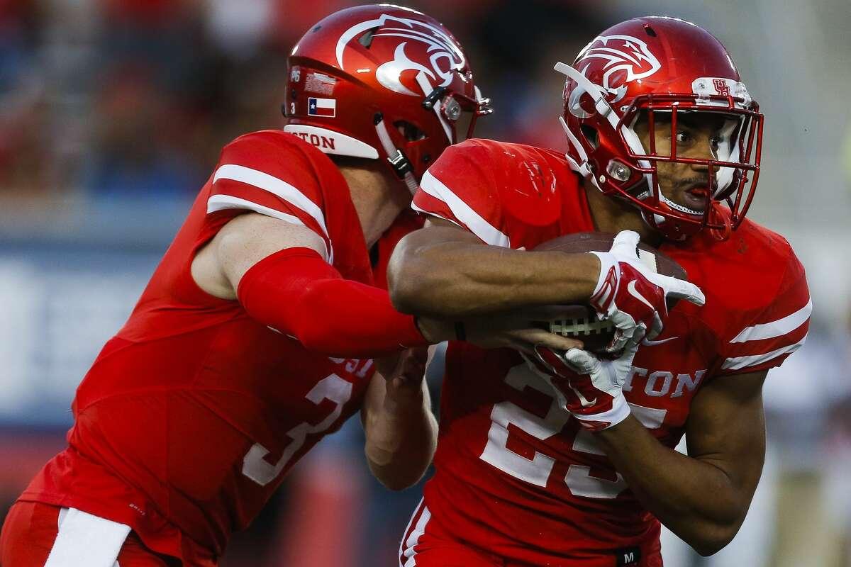 Houston Cougars quarterback Kyle Postma (3) hands off the ball to running back Dillon Birden (25) as the Houston Cougars take on the Tulane Green Wave at TDECU Stadium Saturday, Nov. 12, 2016 in Houston. ( Michael Ciaglo / Houston Chronicle )